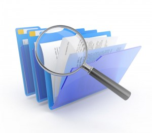 magnifying glass and file folders
